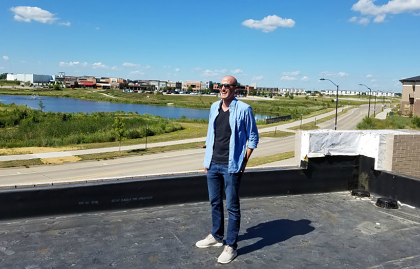Image of Pratum owner Dave Nelson on the roof of the Pratum Headquarters in Ankeny